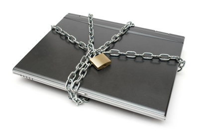 Padlock, chain and laptop isolated on a white background.